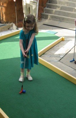 Mini-Golf all by herself at Putterz Ypsilanti