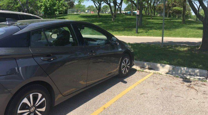 Ann Arbor Buhr Park Pool - Prius Prime parked by Cobblestone Farms