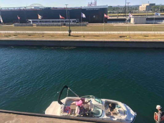 Visit Michigans Upper Peninsula with Kids - Soo Locks - Opposites - American Integrity and a Small Boat