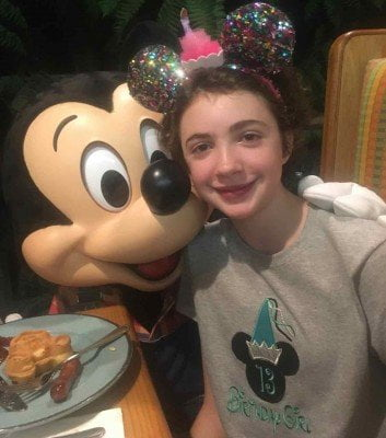 Celebrating her birthday with Mickey